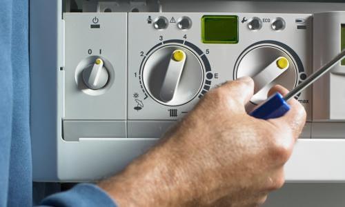 Image shows a member of the team providing a boiler service
